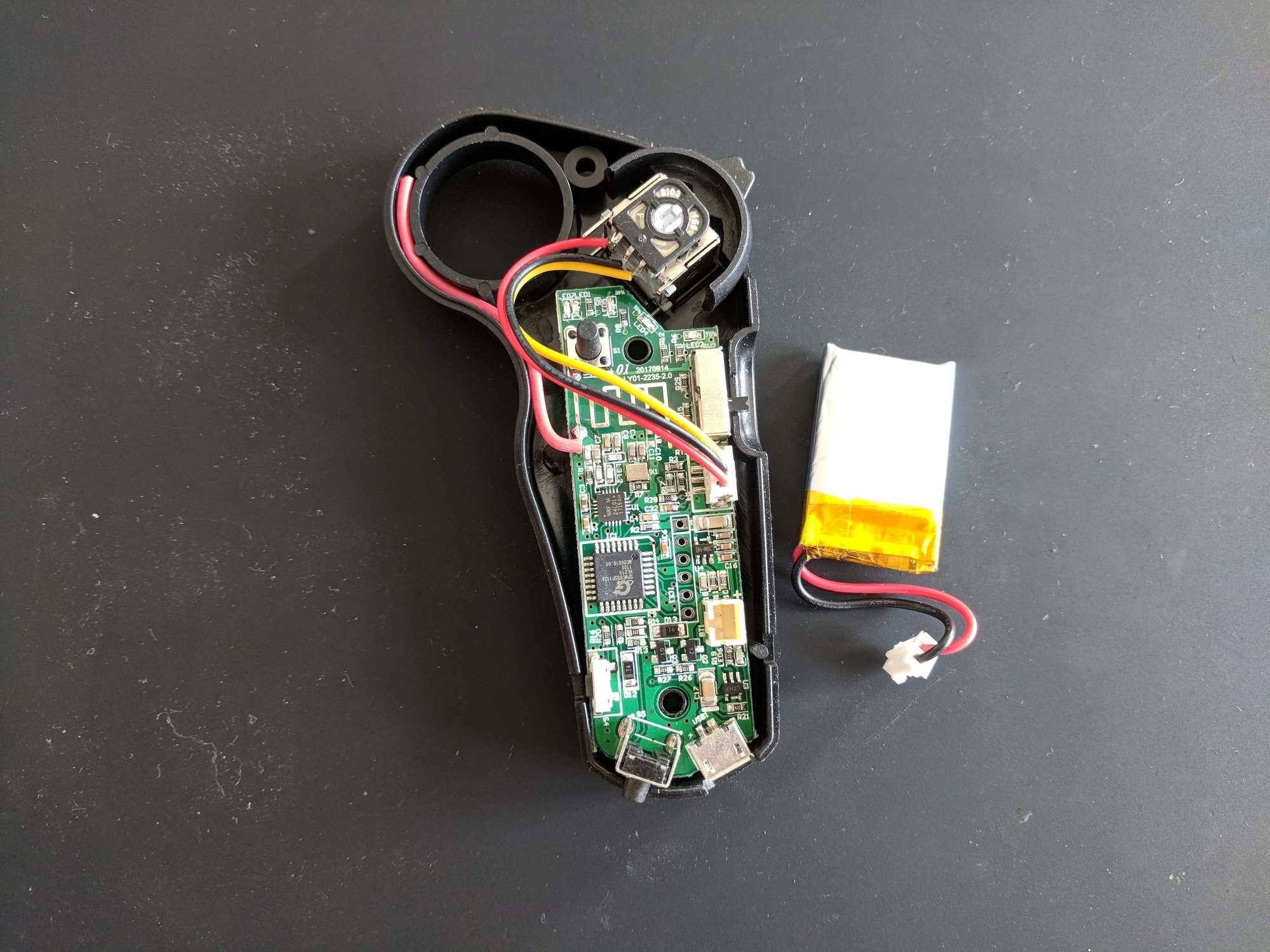 The disassembled remote control with disconnected battery
