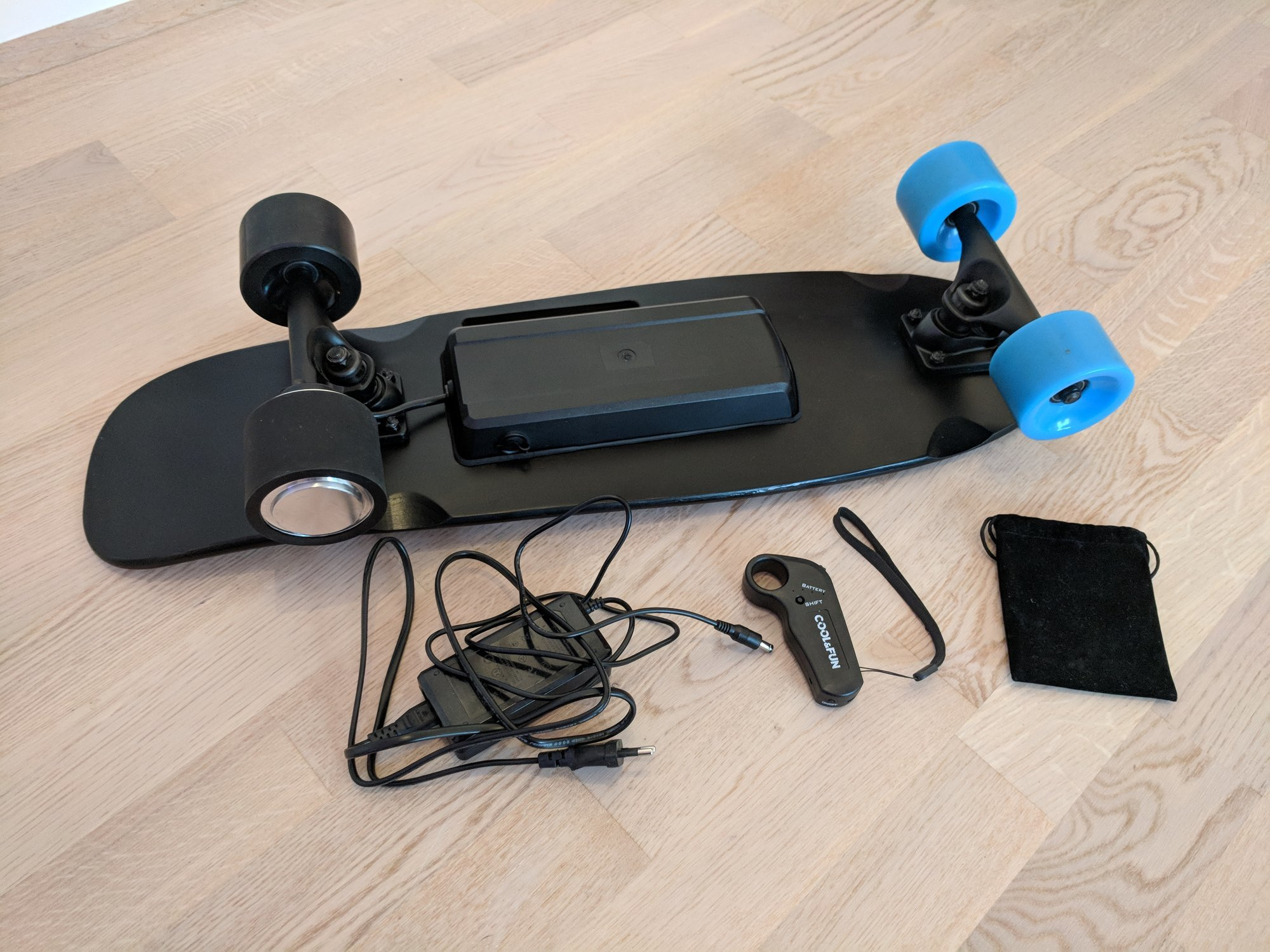 The electric Cool&Fun skateboard laying bottom side up