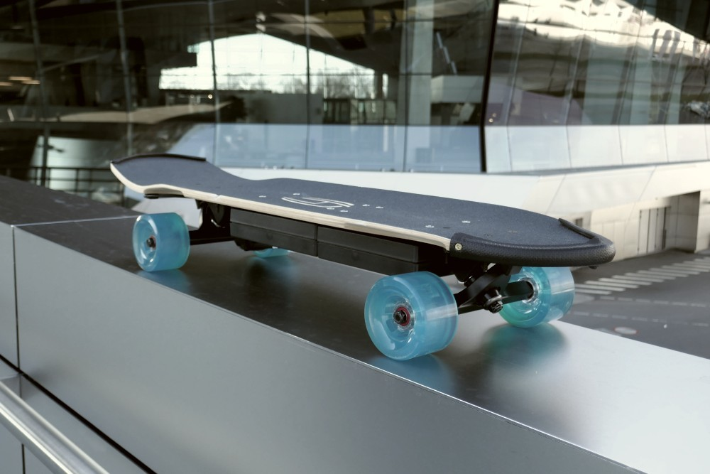 The top side view of the electric board in front of the BMW world
