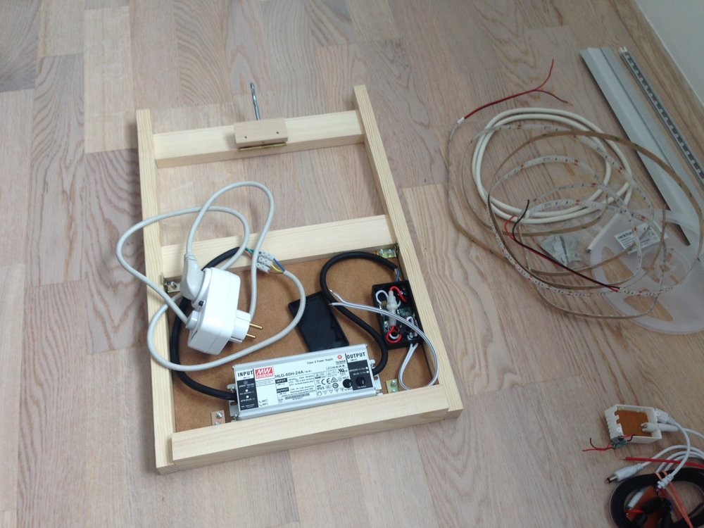 The backframe is build with wood and holds the power supply and the electronics box
